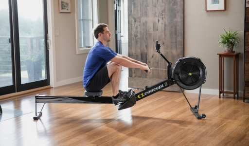 a man using an indoor rowing machine