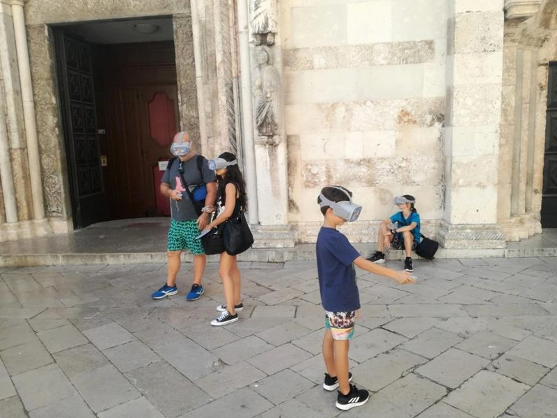 A man, a woman and a boy in front of Zadar cathedral during Zadar Virtual Tour