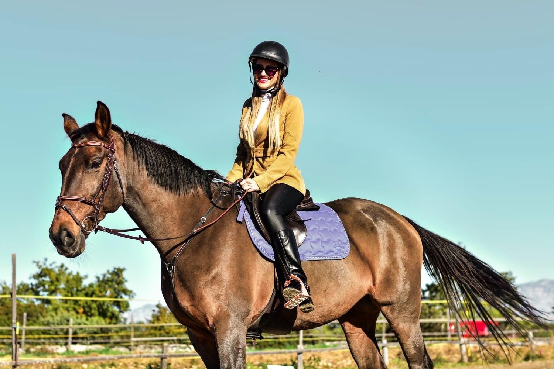 a girl riding a horse on a horseback riding tour