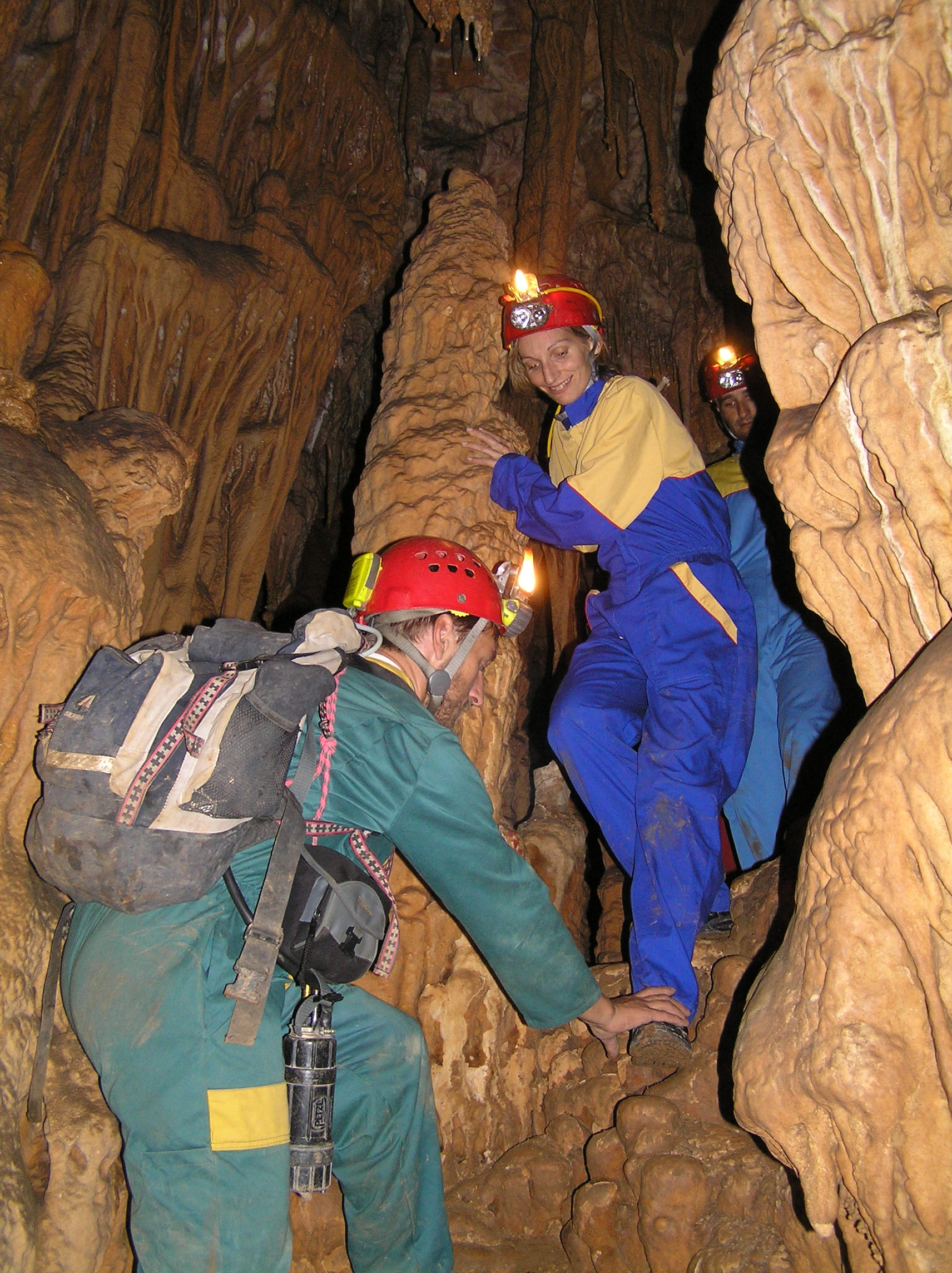 Group of people in tour caving