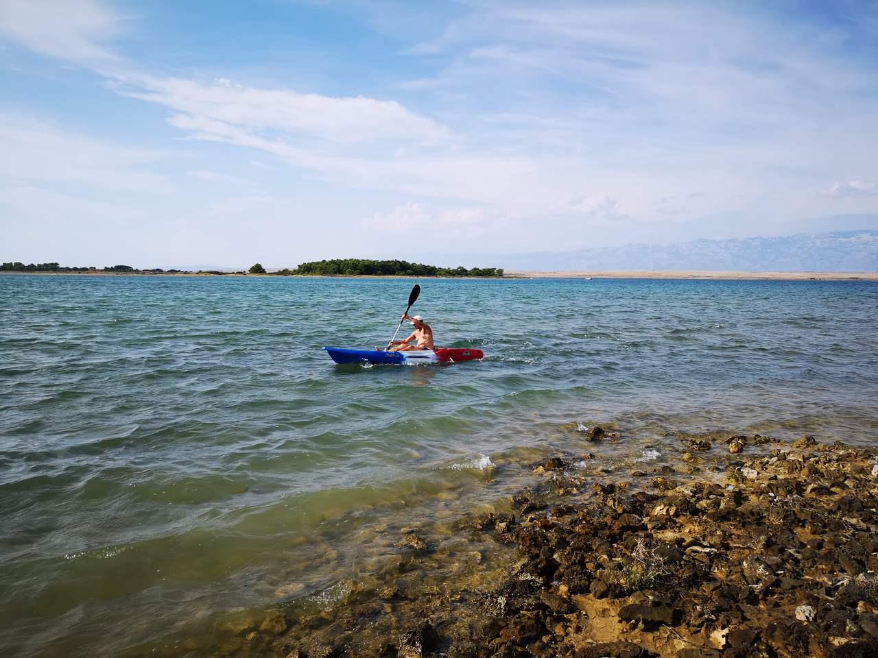 a man in a kayak on the sea