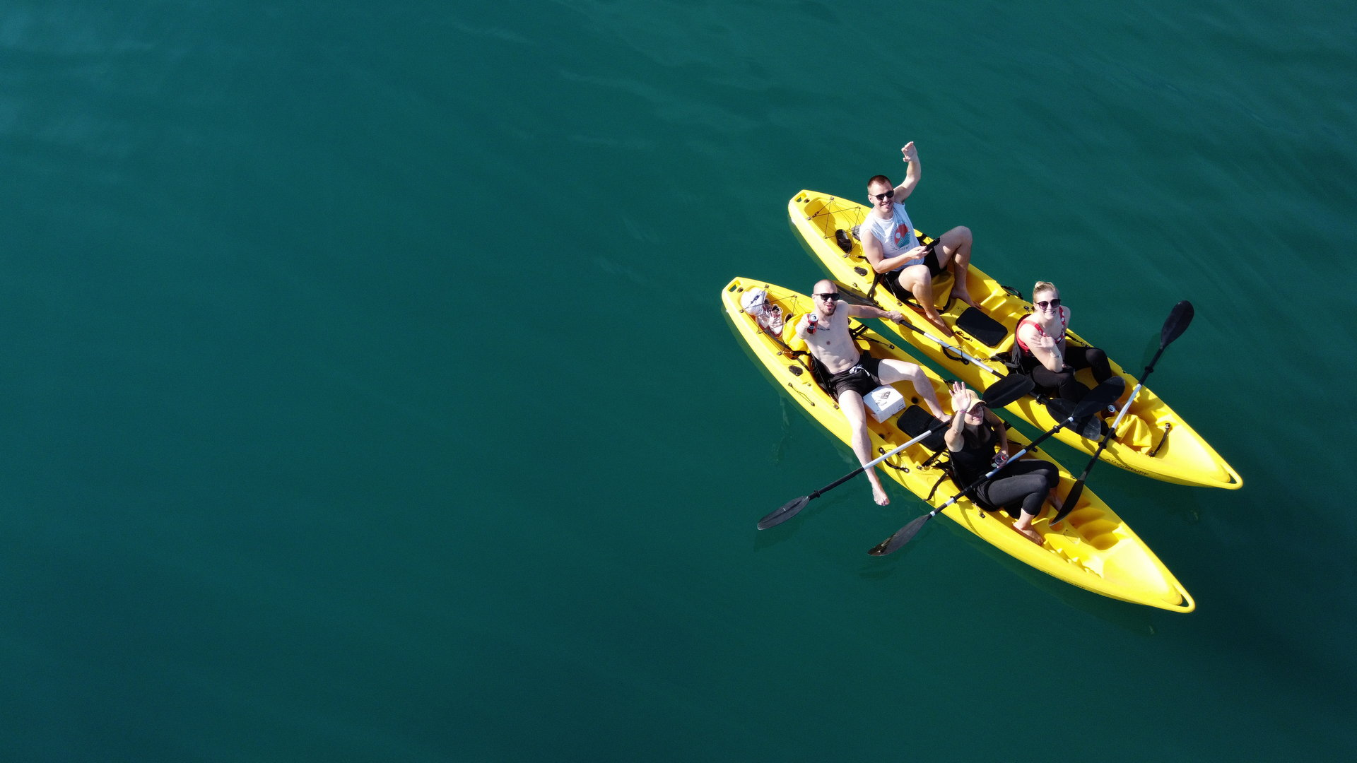 aerial view on two yellow kayaks with people paddling